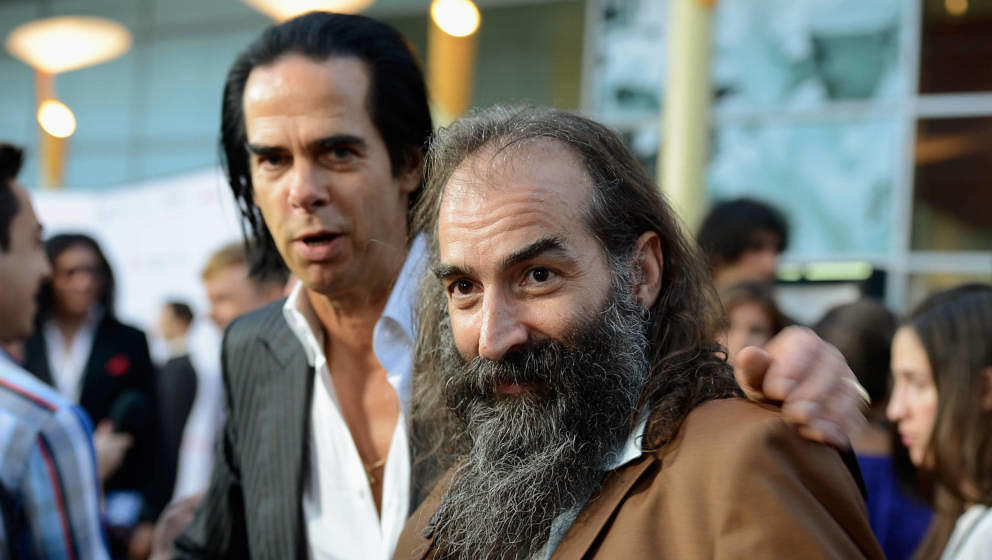 HOLLYWOOD, CA - AUGUST 22:  Screenwriter/composer Nick Cave, (L) and composer Warren Ellis arrive for the premiere of the Wei