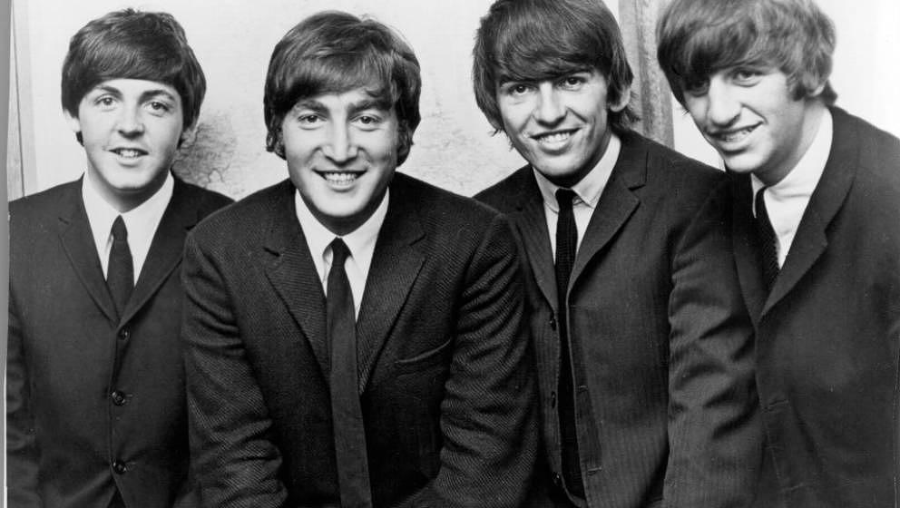 LIVERPOOL - CIRCA 1962:  Rock and roll band 'The Beatles' pose for a portrait in circa 1962. (L-R) Paul McCartney, John Lenno