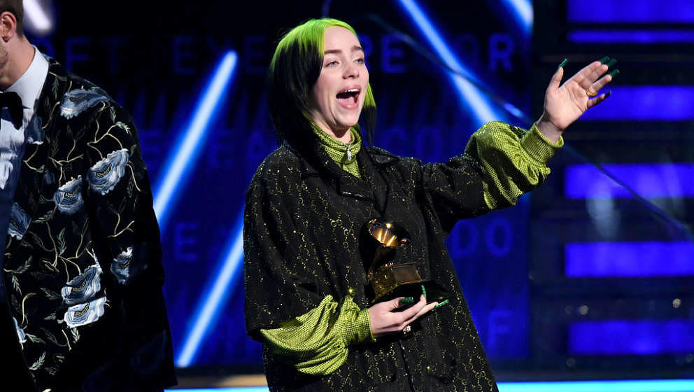 LOS ANGELES, CALIFORNIA - JANUARY 26: Billie Eilish accepts Record of the Year for 'Bad Guy' onstage during the 62nd Annual G