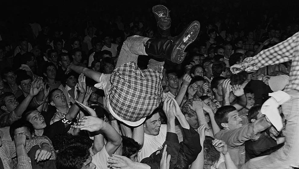RESEDA, CA - 1982:  A concert goer dives into the 'mosh pit' during a 1982 punk rock concert performed by Fear at the Country