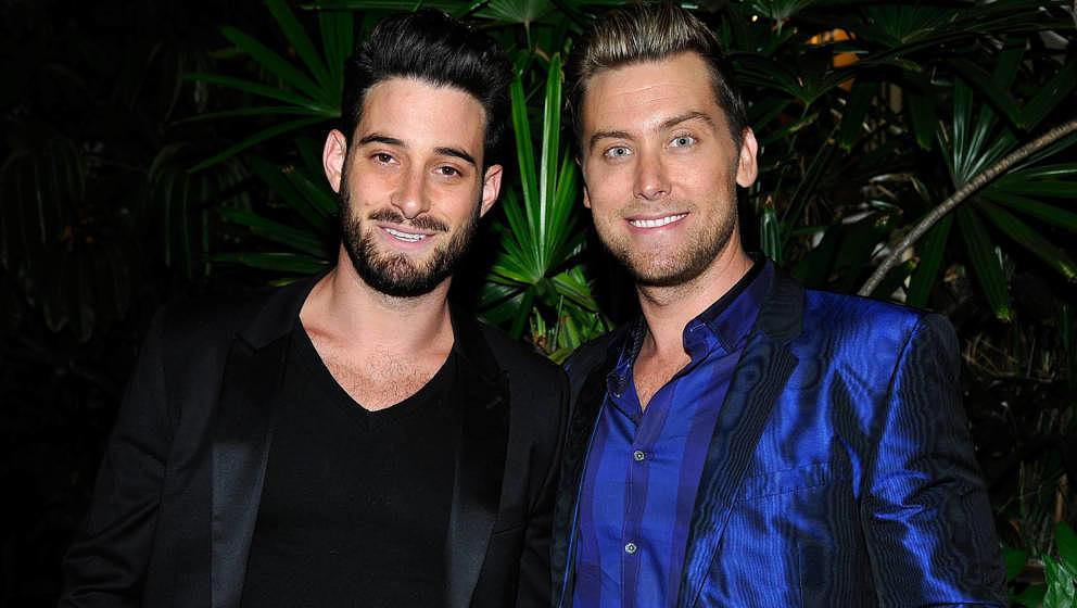 LOS ANGELES, CA - APRIL 23:  Artist Michael Turchin (L) and tv personality Lance Bass attend Opening Ceremony and Calvin Klei