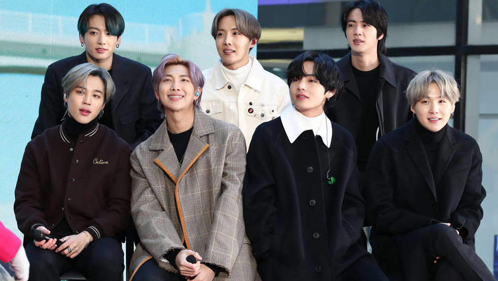 NEW YORK, NEW YORK - FEBRUARY 21:  (L-R) Jimin, Jungkook, RM, J-Hope, V, Jin, and SUGA of the K-pop boy band BTS visit the 'T