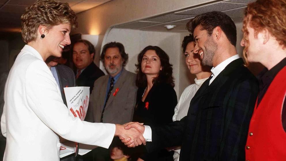 LONDON, UNITED KINGDOM - DECEMBER 01:  Princess Diana Meeting Pop Singers George Michael, Kd Lang And Mick Hucknall At The Wo