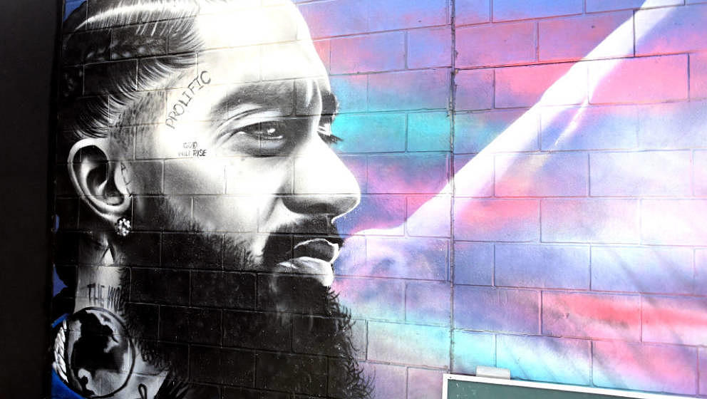 ANAHEIM, CALIFORNIA - AUGUST 10: A view of a Nipsey Hussle tribute mural at the 92.3 Real Street Festival at Honda Center on