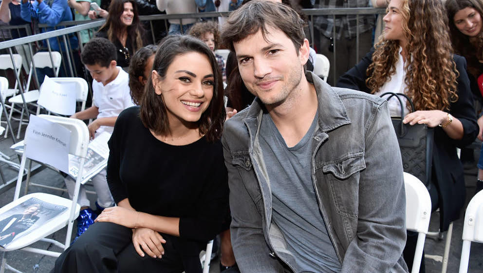 HOLLYWOOD, CA - MAY 03:  Actors Mila Kunis (L) and Ashton Kutcher at the Zoe Saldana Walk Of Fame Star Ceremony on May 3, 201