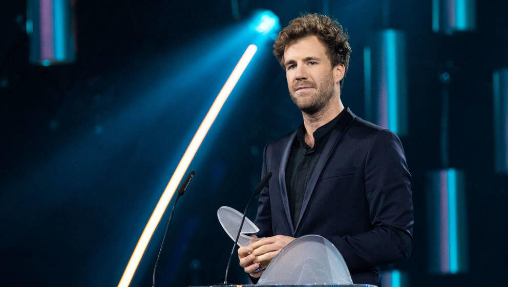 COLOGNE, GERMANY - OCTOBER 02: Luke Mockridge accepts the award for 'Best Comedian' during the 23rd annual German Comedy Awar