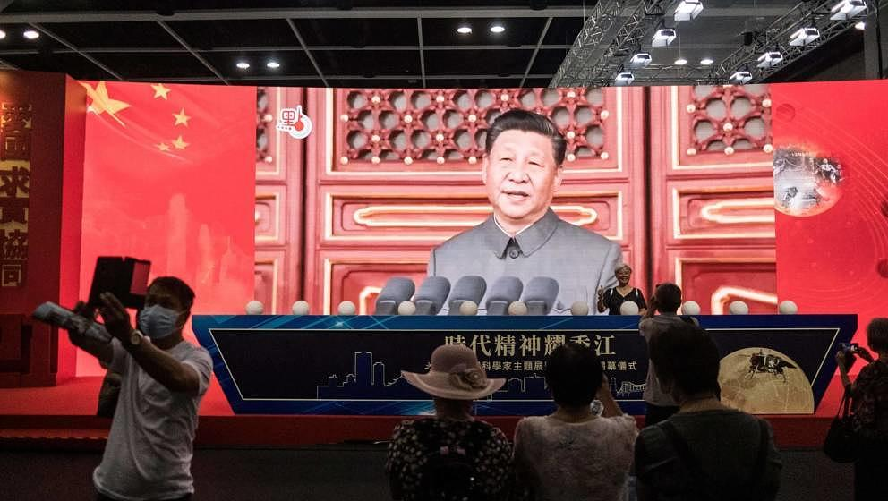 In this picture taken at the Hong Kong Convention and Exhibition Centre in Hong Kong on July 8, 2021, visitors take photos at