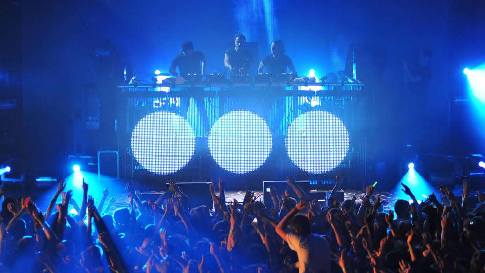 LONDON, UNITED KINGDOM - JULY 21: (L-R) Steve Angello, Sebastian Ingrosso and Axwell of Swedish House Mafia performs on stage