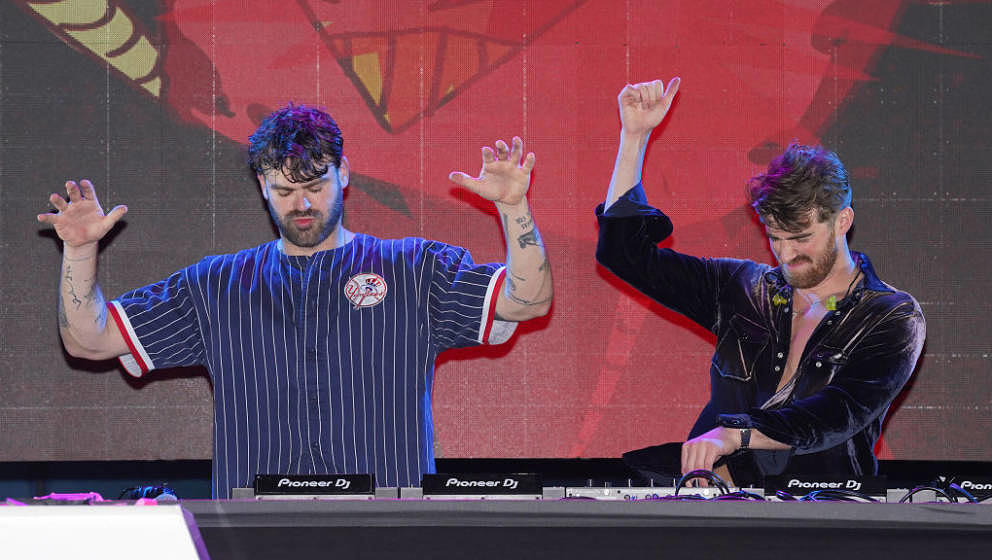 MIAMI BEACH, FLORIDA - MAY 20: Alexander Pall and Andrew Taggart of The Chainsmokers perform onstage to kick off the 20th Ann